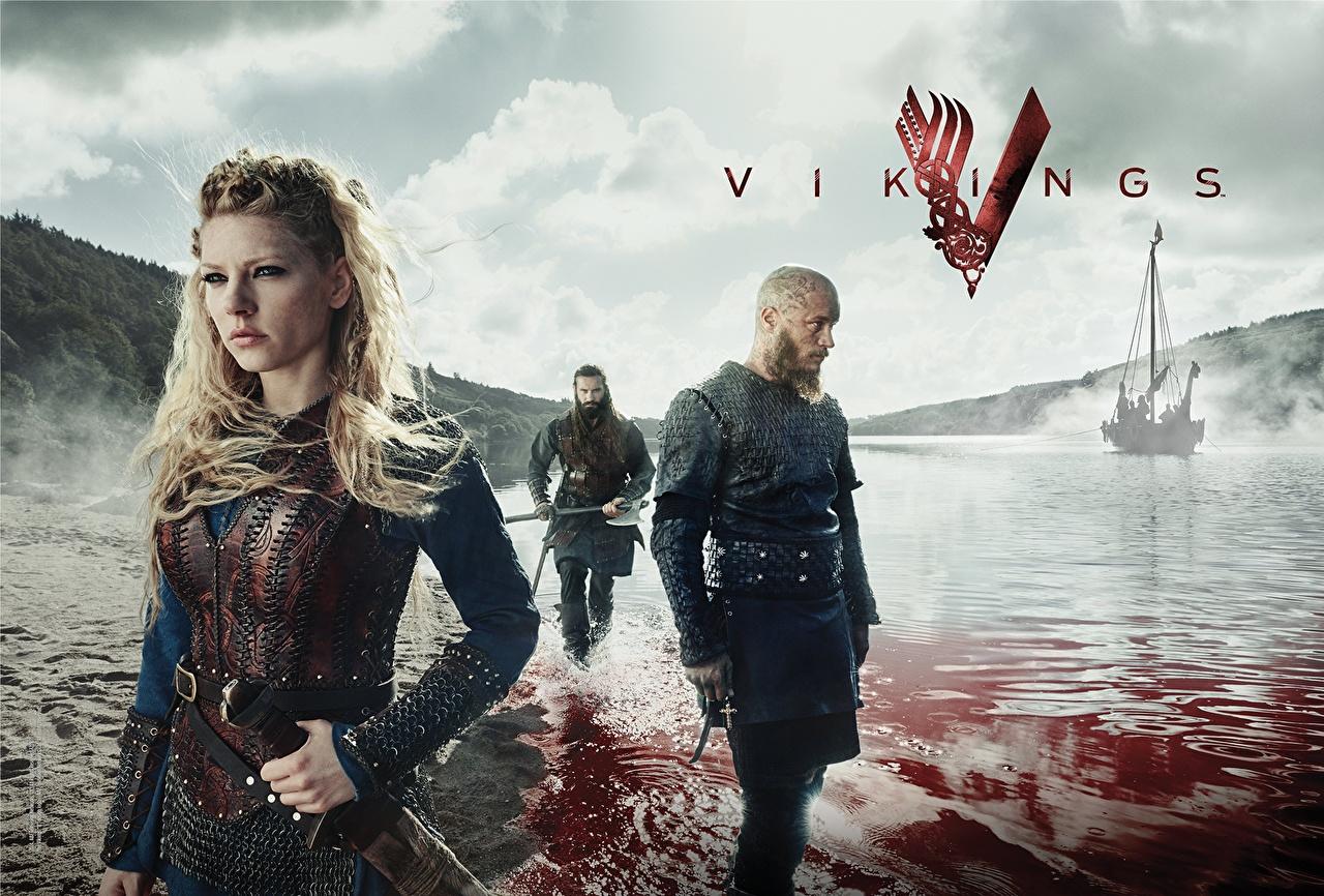 Achtergrond Beroemdheden Vikings (televisieserie) Katheryn Winnick een man Blond meisje Logo embleem Ragnar Lodbrok, Travis Fimmel Films schip Bloed Water Jonge vrouwen Mannen Blonde film Schepen jonge vrouw