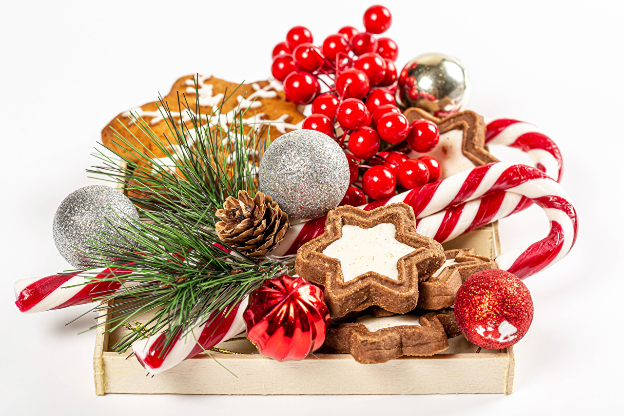 Image New year Lollipop Food Berry Balls Cookies Branches Conifer cone White background Christmas Pine cone
