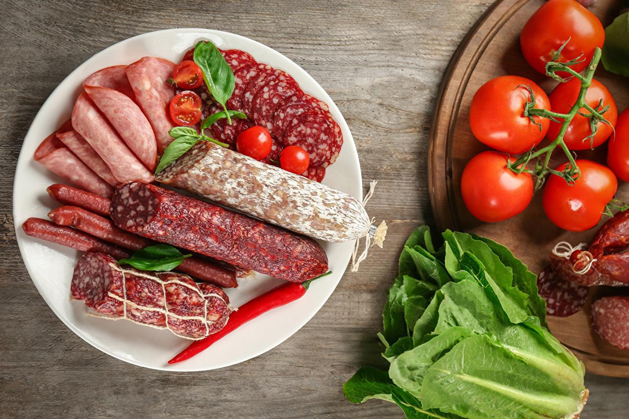 Foto Wurst Tomate Teller Gemüse Lebensmittel geschnittene Geschnitten geschnittenes