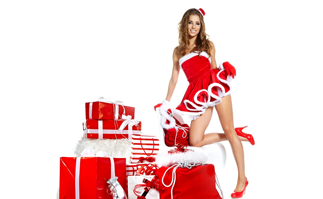 Image Izabela Magier New year Smile posing Girls Legs Gifts White background Stilettos Christmas Pose female young woman present high heels