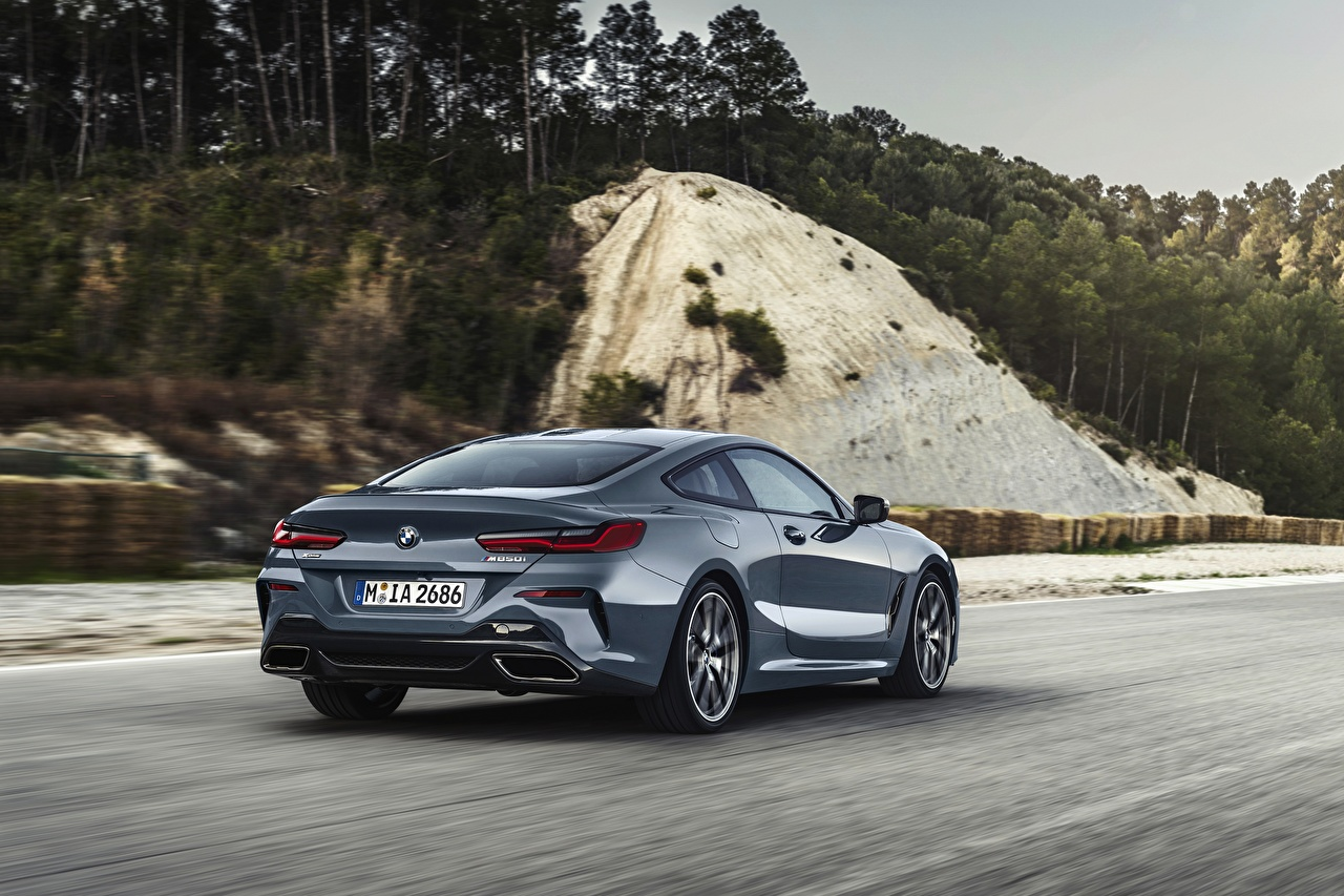 Photos BMW 8-Series 2018 M850i xDrive Coupe Motion Cars Back view moving riding driving at speed auto automobile