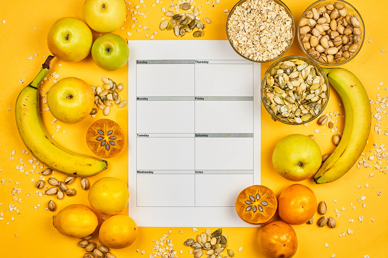 Picture Healthy eating Oatmeal Calendar Persimmon Apples Lemons Bananas Food Nuts Colored background kaki