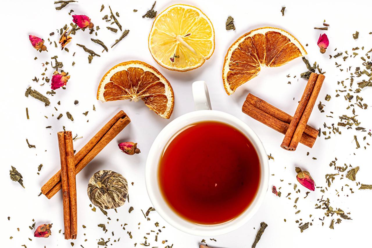 Picture Tea Orange fruit Lemons Cinnamon Cup Food White background