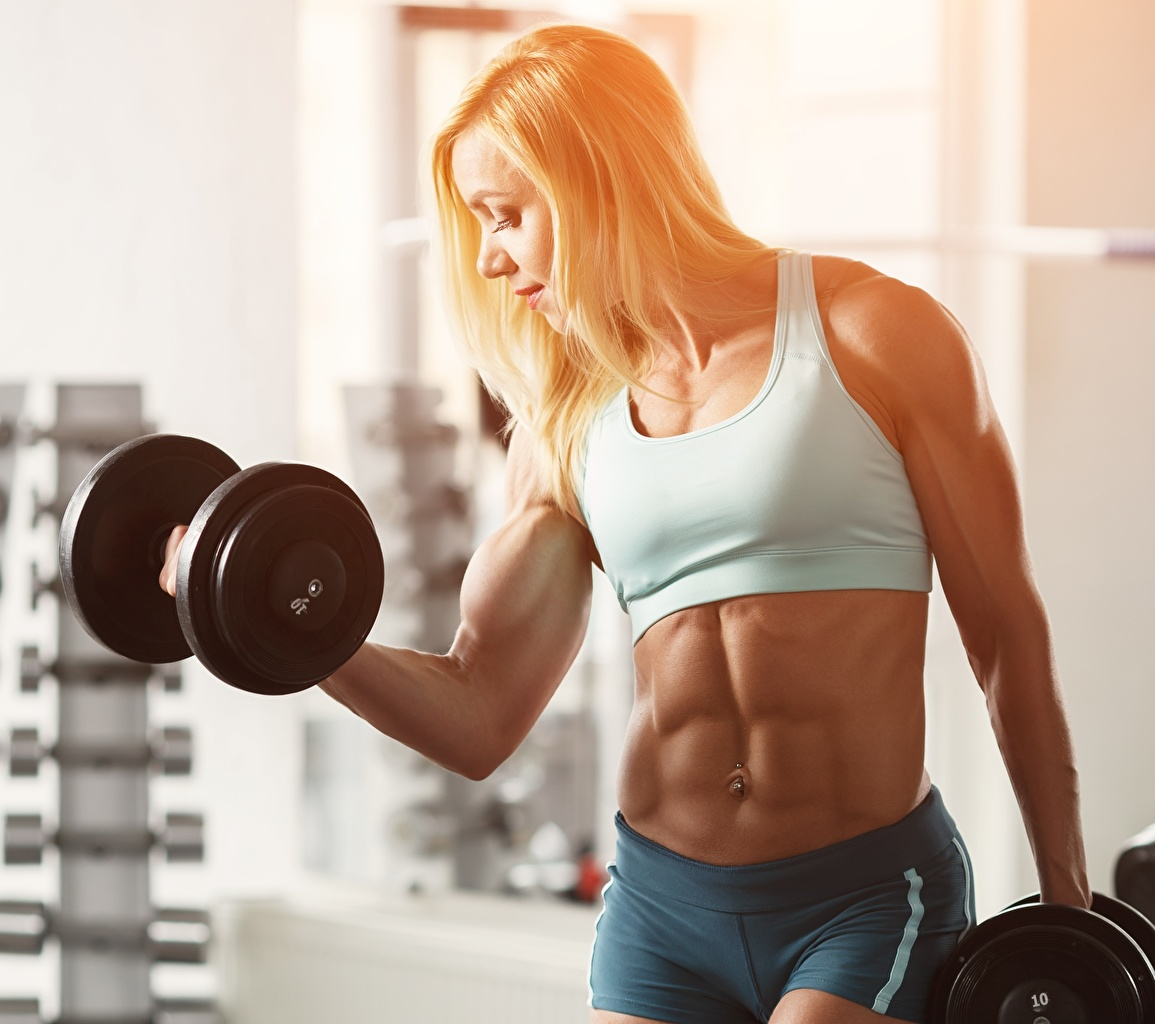 Pictures Blonde girl Muscle Workout blurred background Fitness Girls Dumbbells Bodybuilding Belly Hands Physical exercise Bokeh female dumbbell young woman