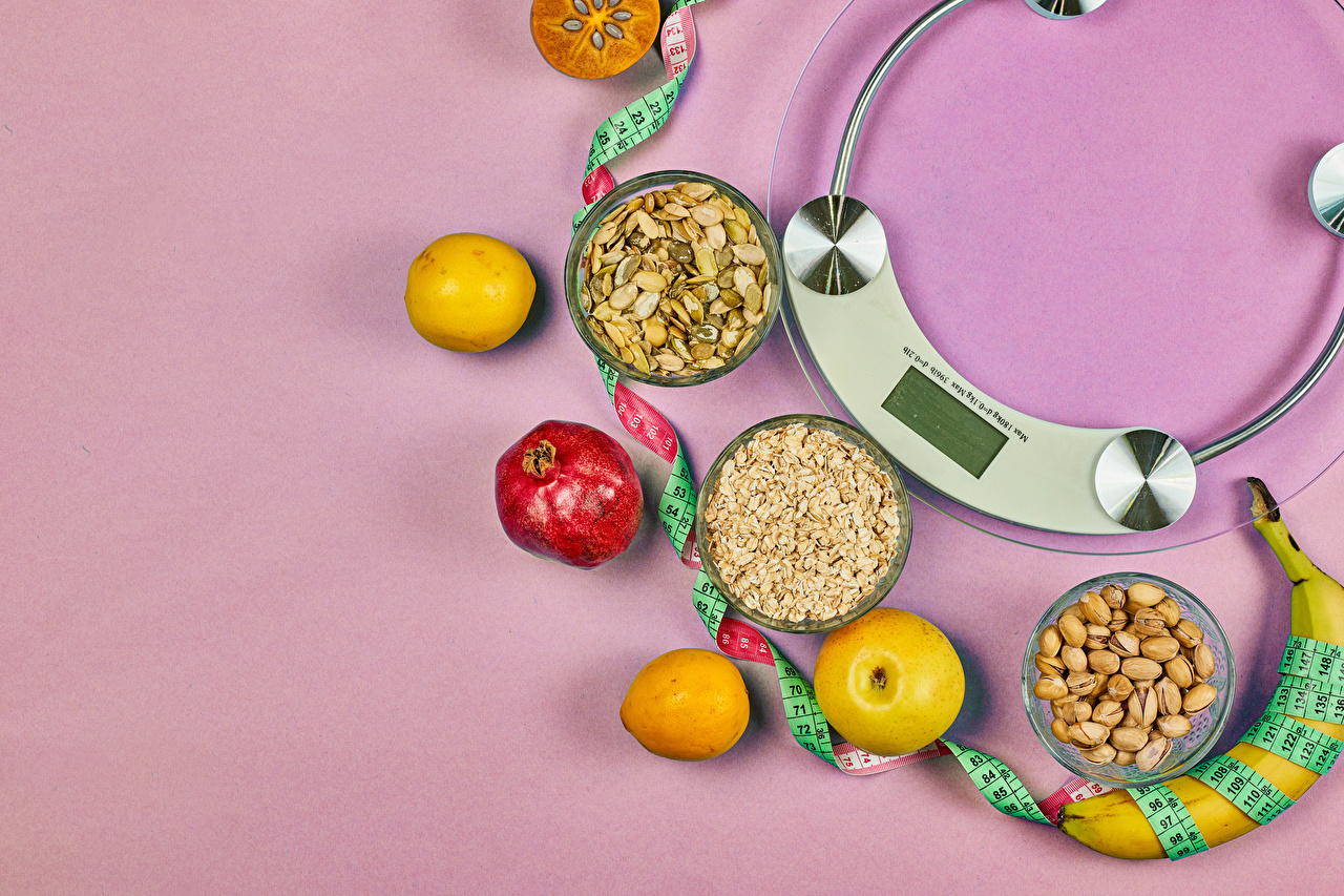 Picture Healthy eating Tape measure Oatmeal Apples Lemons Bananas Pomegranate Food Nuts Colored background