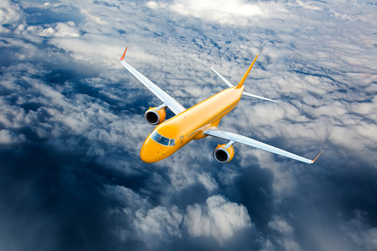 Bilder Flugzeuge Verkehrsflugzeug Gelb Himmel Flug Wolke Luftfahrt