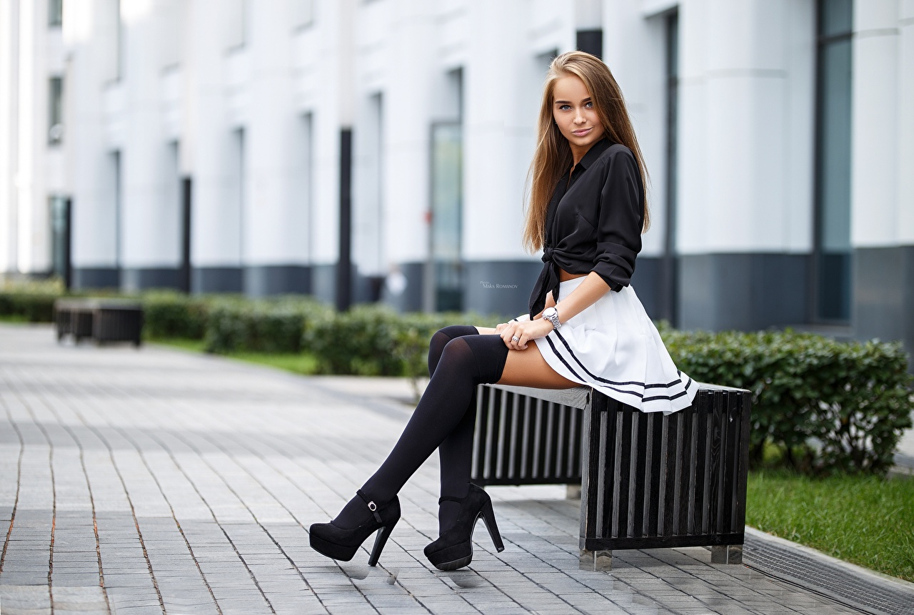 Photo Skirt Knee highs Brown haired Maksim Romanov Girls Sitting high heels female young woman sit Stilettos