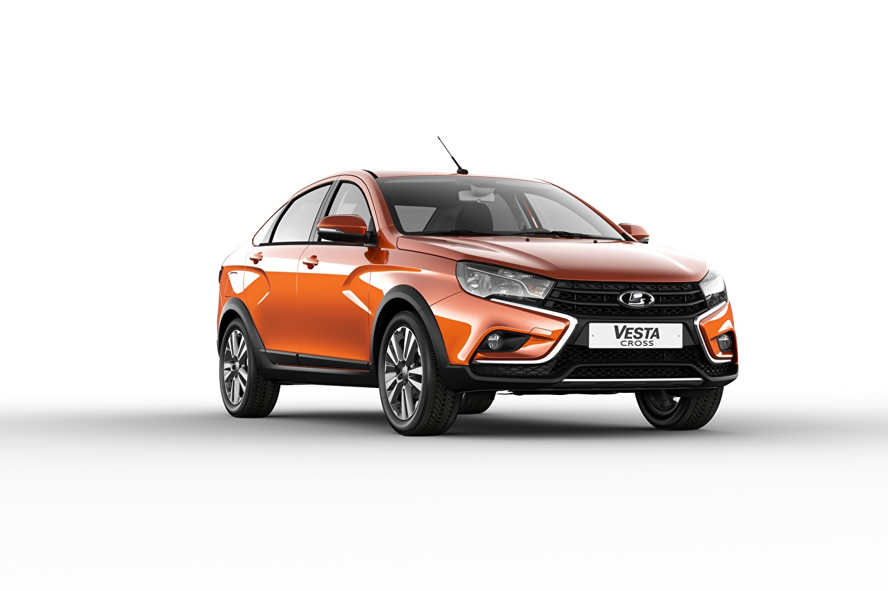 Desktop Wallpapers Lada Russian cars Vesta Cross 2018 Sedan Orange auto Metallic White background Cars automobile