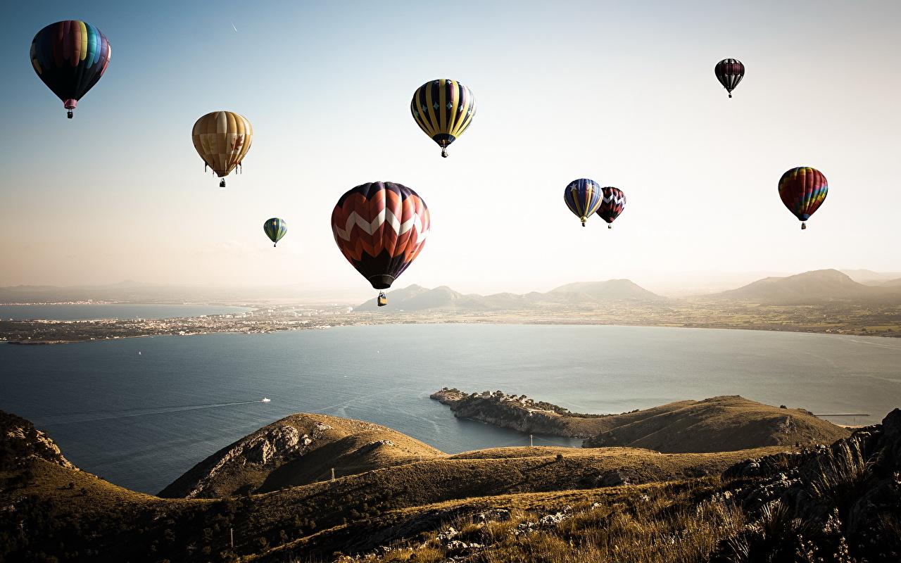 Image balloon (aeronautics) Nature athletic Sky Flight Landscape design Aerostat Sport sports