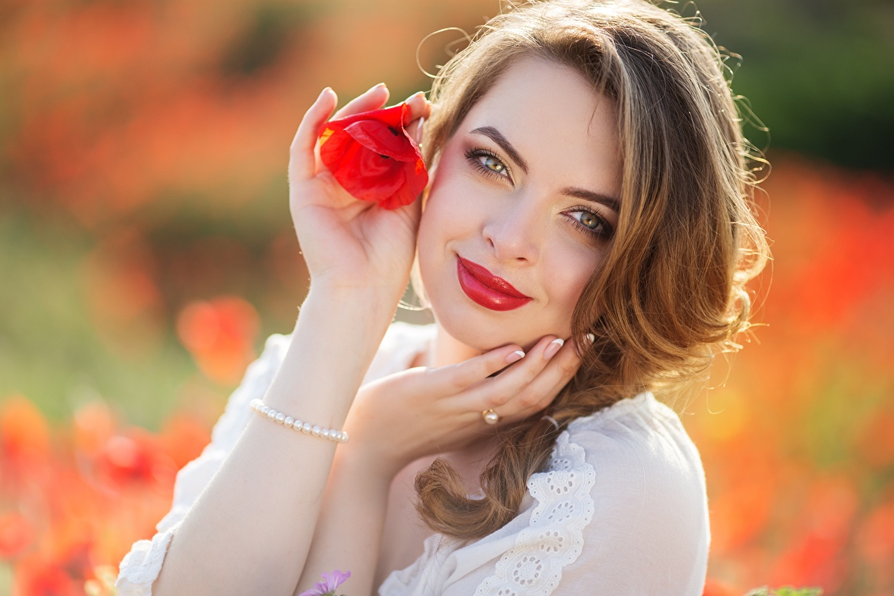 Picture Brown haired Smile blurred background female papaver Hands Glance Red lips Bokeh Girls young woman Poppies Staring