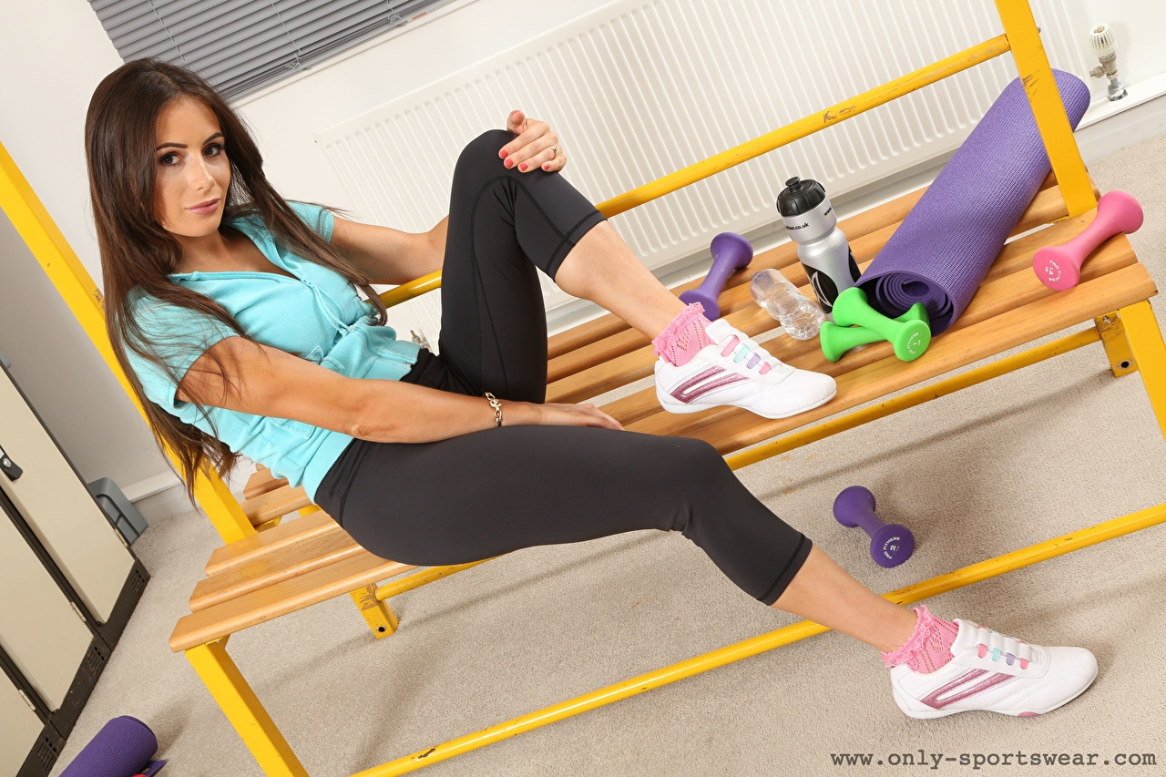 Photo Laura Hollyman Brown haired Fitness Girls Athletic shoe Legs sit female sneakers trainers young woman Sitting
