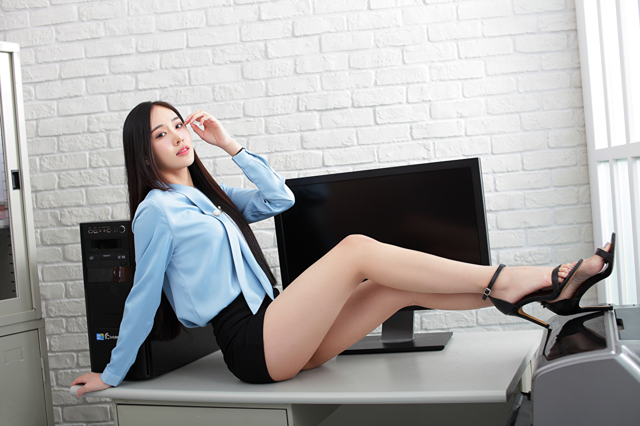 Images Skirt Secretaries Blouse Girls Legs Asian Table Sitting Glance Office female young woman Asiatic sit Staring