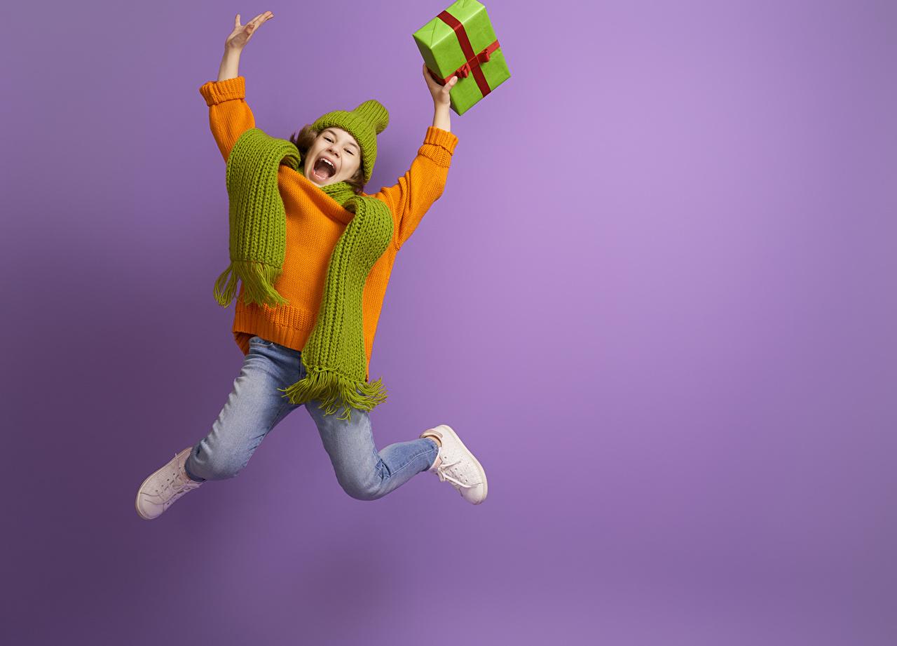 Desktop Wallpapers Little girls Scarf happy Children Jump present Sweater Hands Colored background Joy joyful child Gifts
