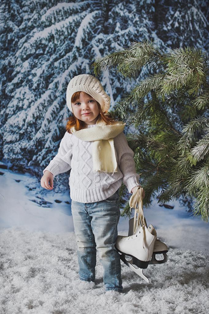 Image Little girls Ice skate Children Winter Winter hat Jeans Sweater Glance  for Mobile phone child Staring