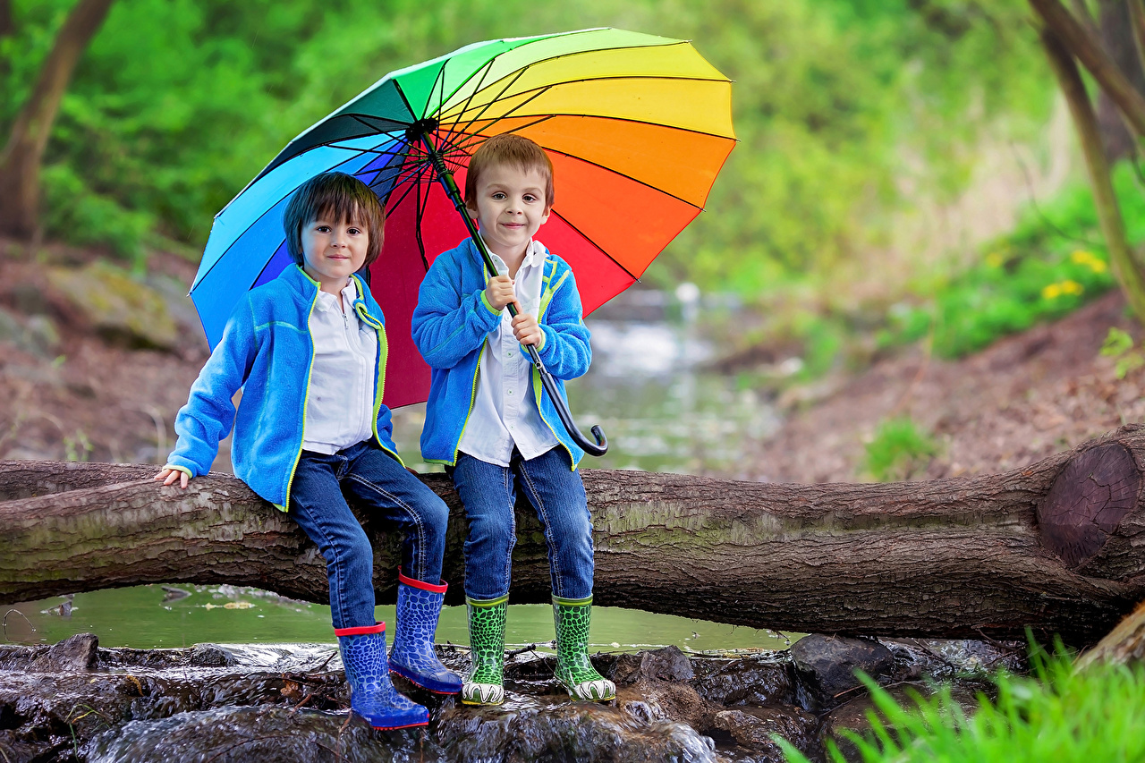 Image Boys Wearing boots Children Two Jeans Trunk tree sit Umbrella child 2 parasol Sitting