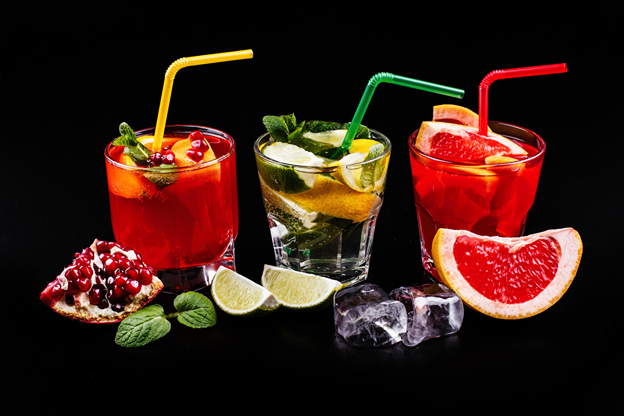 Picture Alcoholic drink Ice Lime Grapefruit Pomegranate Highball glass Food Three 3 Cocktail Black background Mixed drink