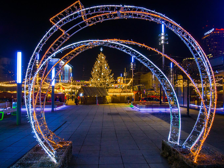 Wallpaper Poland Christmas Katowice New Year tree Street Evening Fairy lights Houses Cities New year Christmas tree Building