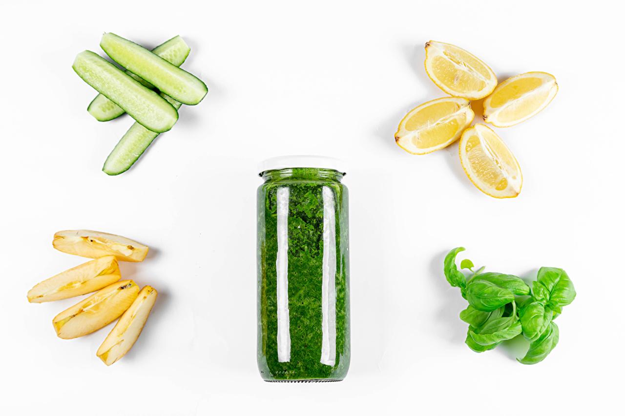 Photo Cucumbers Jar Lemons Apples pieces Food Vegetables White background Piece