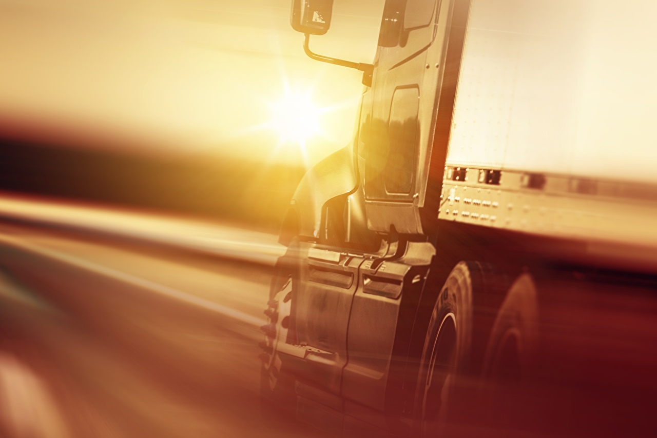 Desktop Wallpapers lorry Motion automobile Closeup Trucks moving riding driving at speed Cars auto