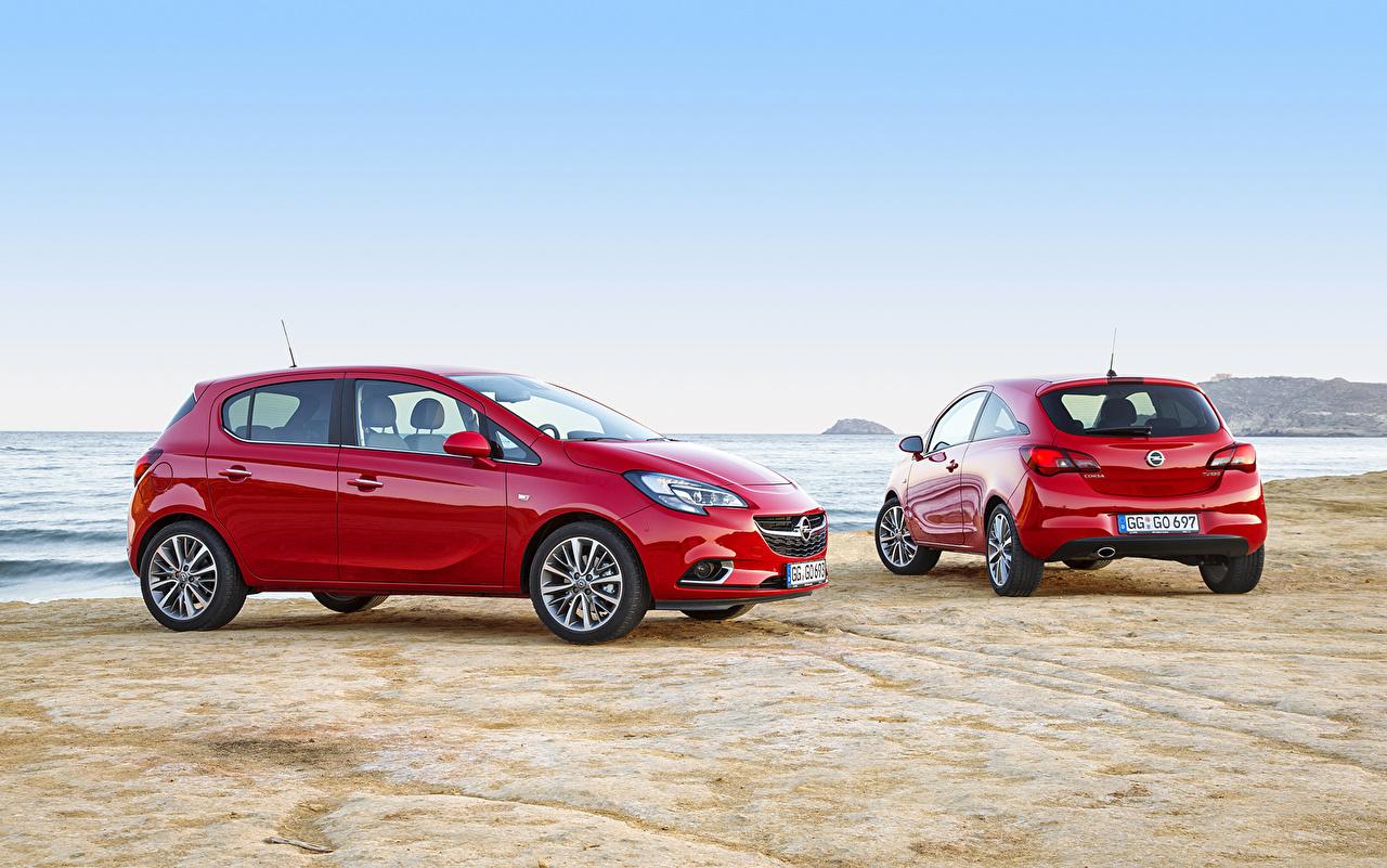 Photo Opel 2015 Corsa 2 Red Coast Metallic automobile Two Cars auto