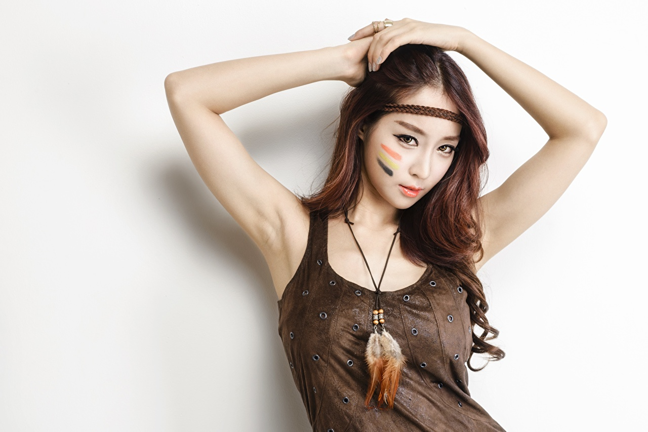 Image Brown haired Makeup Beautiful Girls Asian Hands Glance Gray background female young woman Asiatic Staring