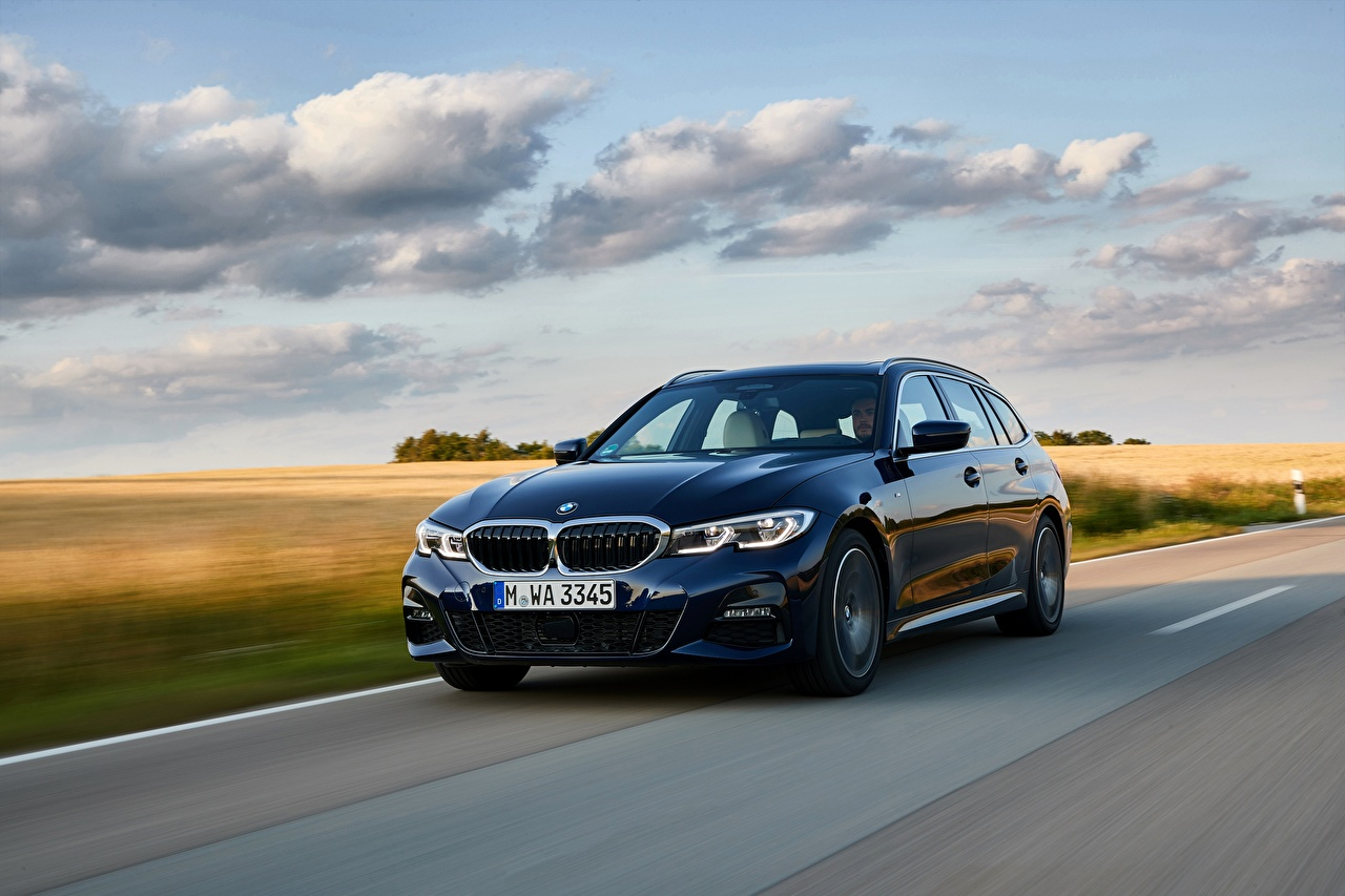 Wallpaper BMW Station wagon 3er 2020 G21 330d xDrive Touring Blue riding auto Estate car moving Motion driving at speed Cars automobile