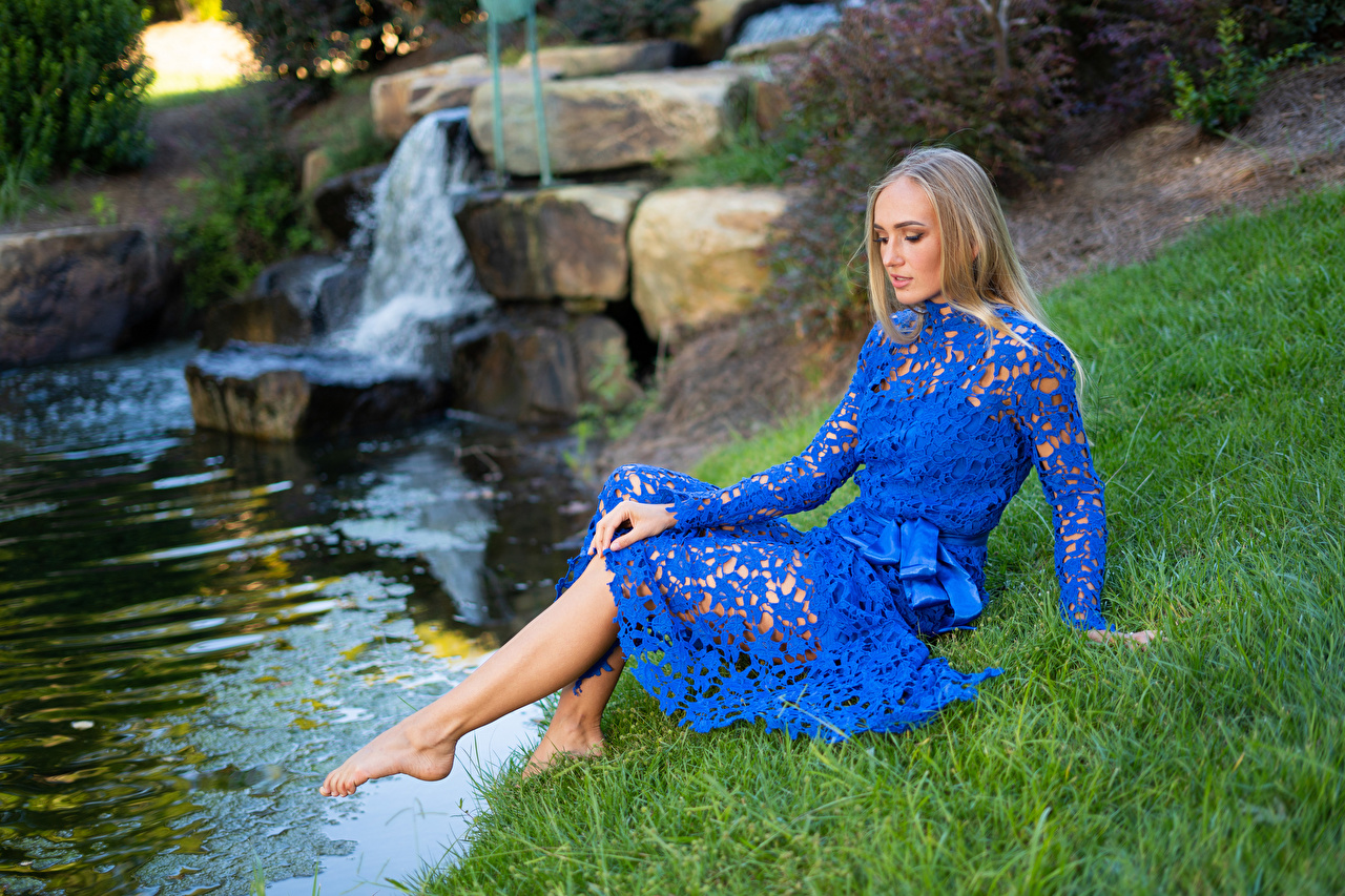 Pictures female Olga Clevenger Grass Sitting Creek Legs Dress Blonde girl Girls young woman sit brook Creeks Stream Streams gown frock