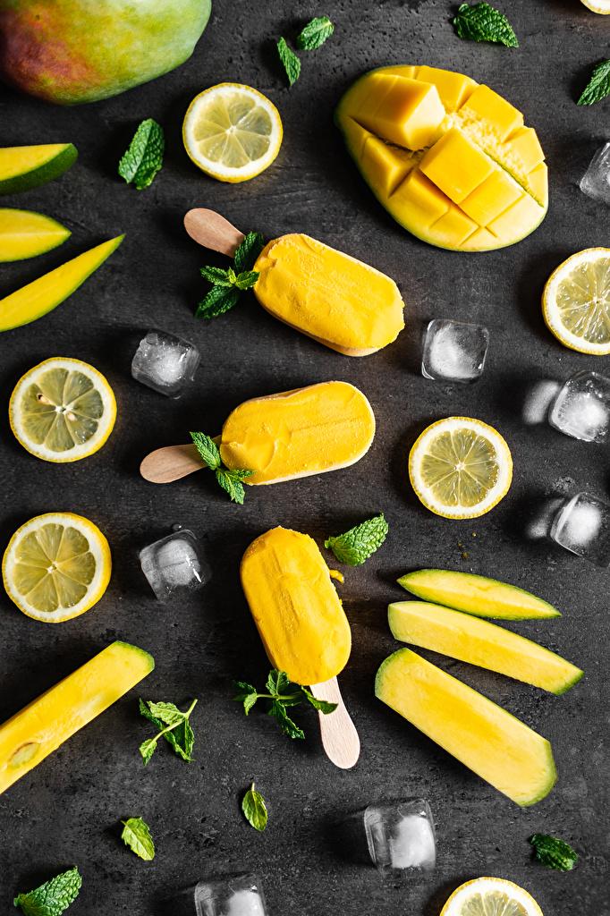 Bilder Eis Mango Speiseeis Dauerlutscher Zitronen das Essen geschnittene  für Handy Zitrone Geschnitten Lebensmittel geschnittenes