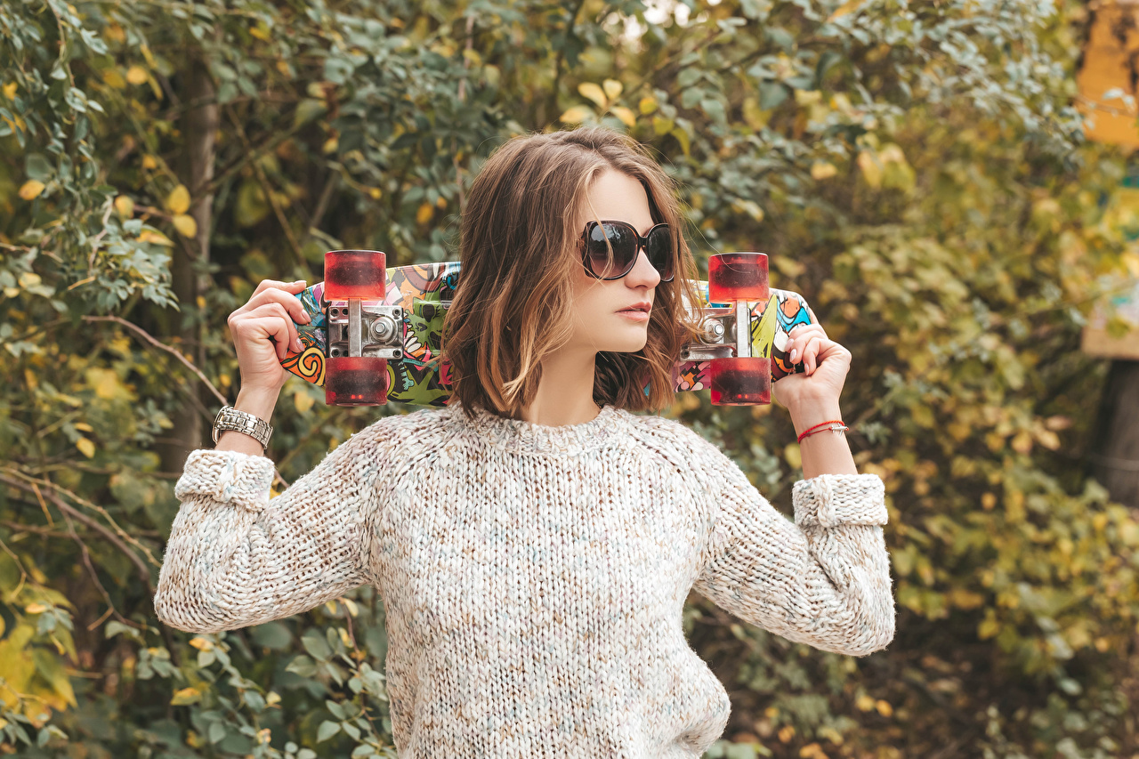 Image Brown haired female Sweater Skateboard Hands Glasses Girls young woman eyeglasses