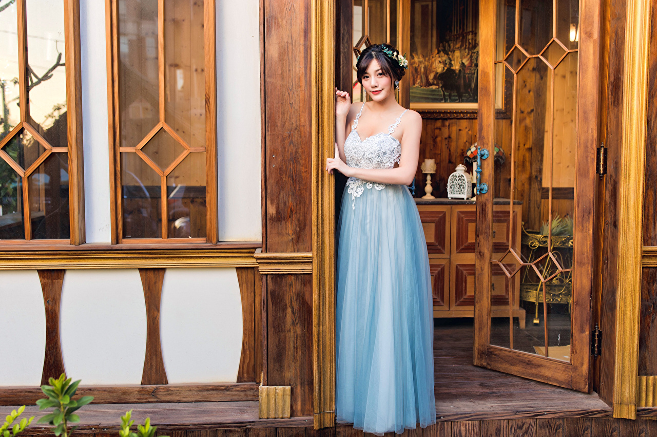 Picture posing young woman Asiatic Door Glance frock Pose Girls female Asian doors Staring gown Dress