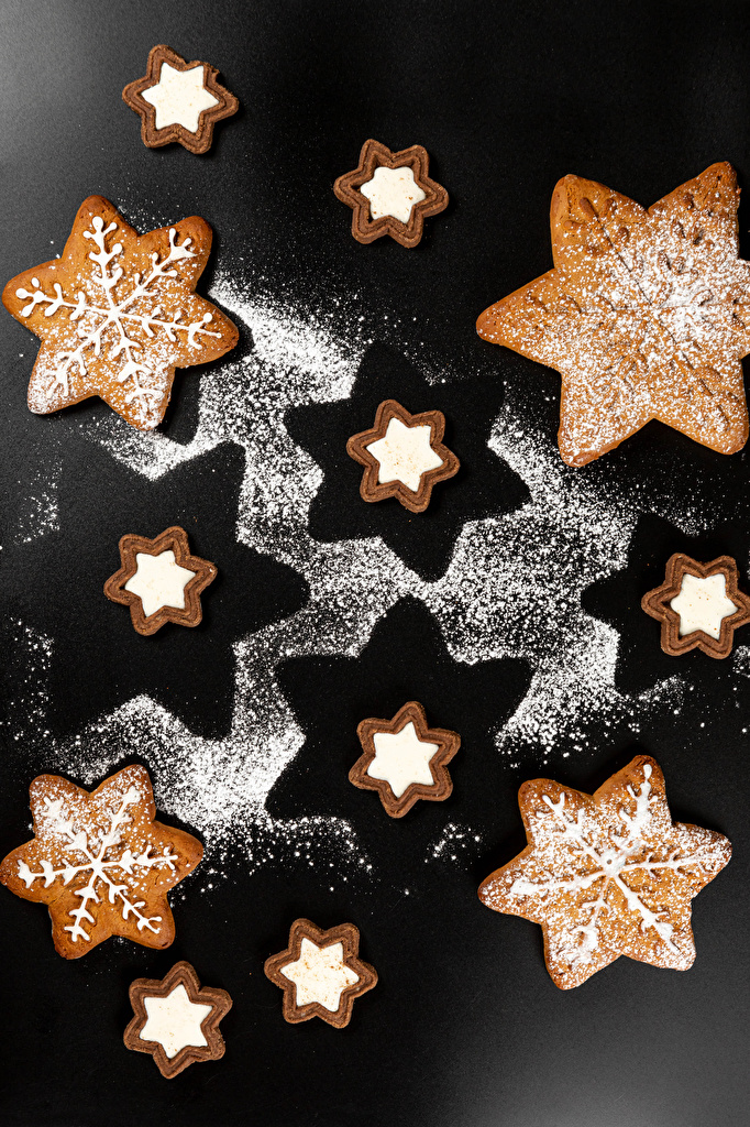 Pictures Christmas Snowflakes Powdered sugar Food Cookies Gray background Design  for Mobile phone New year
