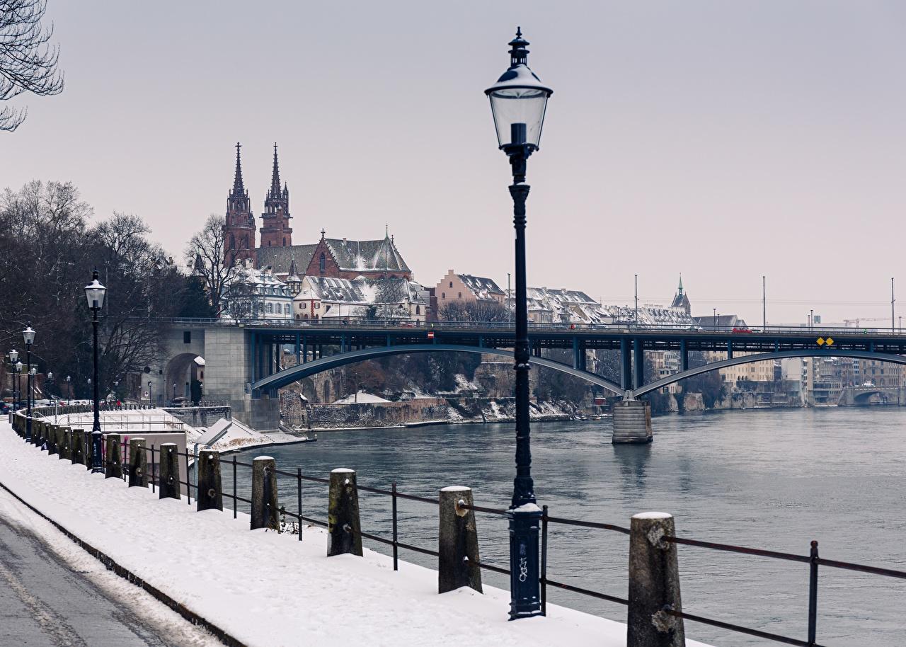 Picture Switzerland Basel, Rhine, Munster Winter Bridges Snow Fence Rivers Street lights Cities bridge river