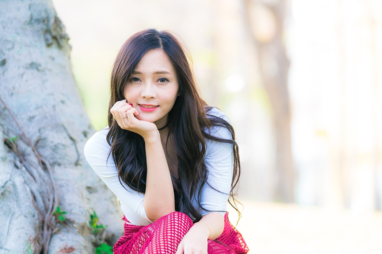 Pictures Smile Bokeh female Asian Hands Glance blurred background Girls young woman Asiatic Staring
