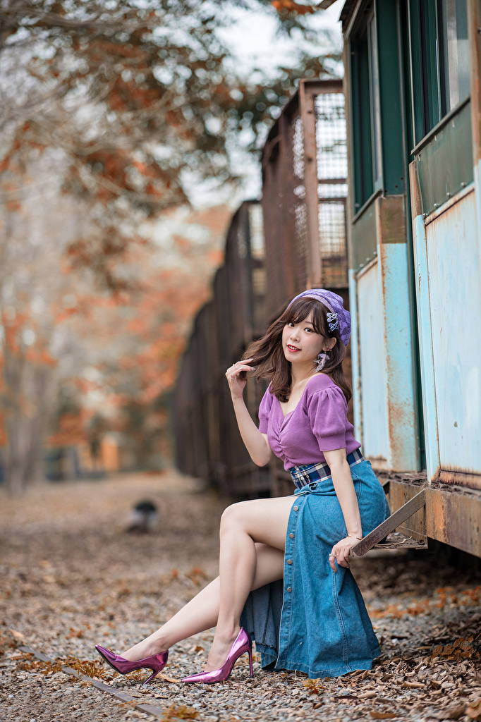 Images Skirt Brown haired blurred background posing Blouse Girls Legs Asian Sitting  for Mobile phone Bokeh Pose female young woman Asiatic sit