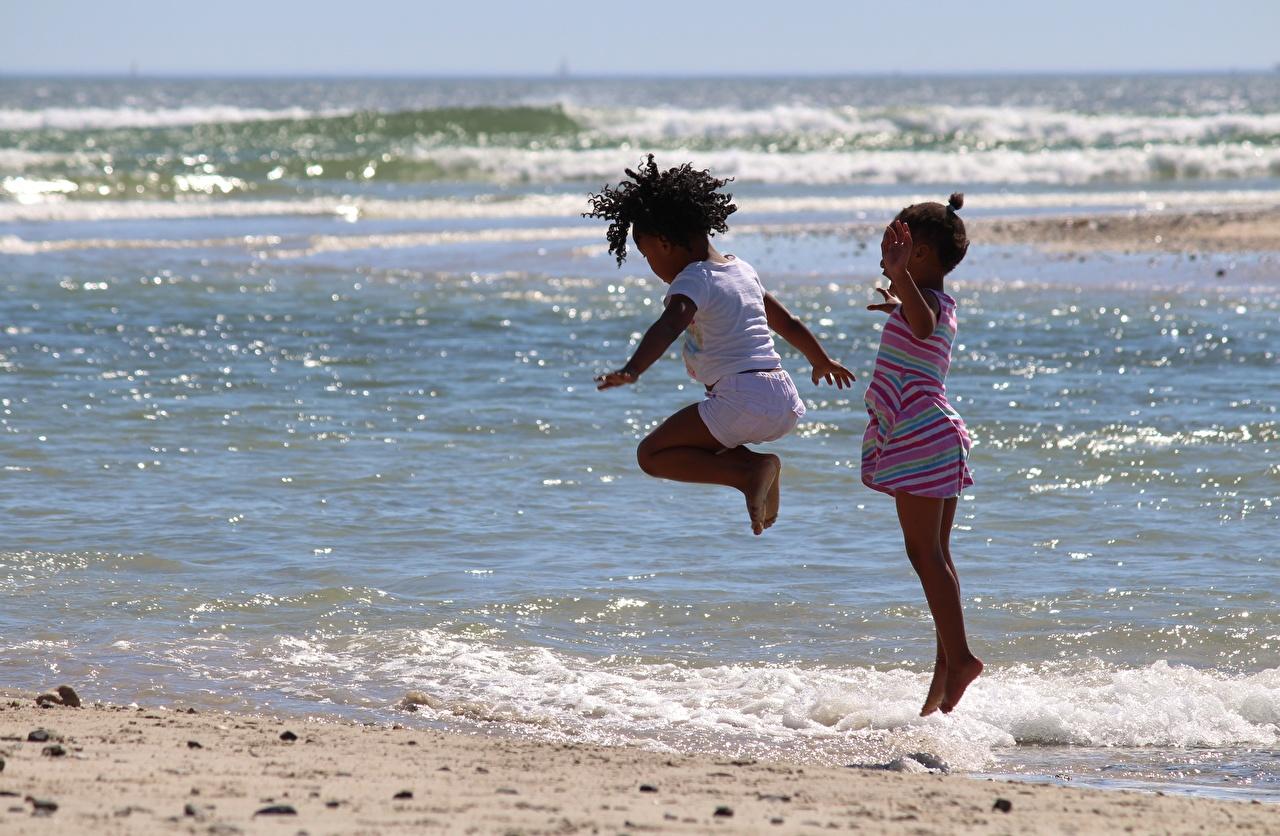 Desktop Wallpapers Little girls Children Sea Two Negroid Jump child 2