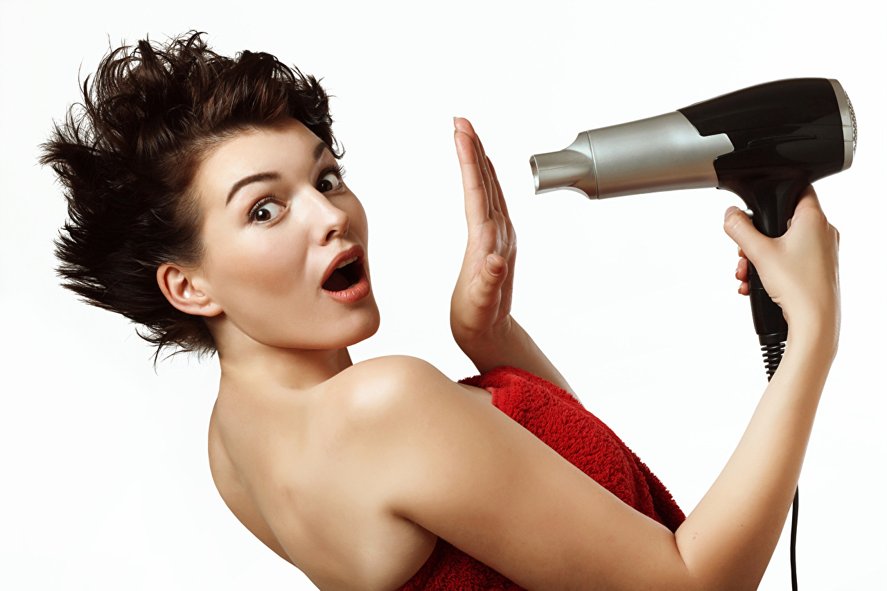 Images Brown haired Surprise emotion Hair dryer Girls Hands Staring White background hairdryer Glance