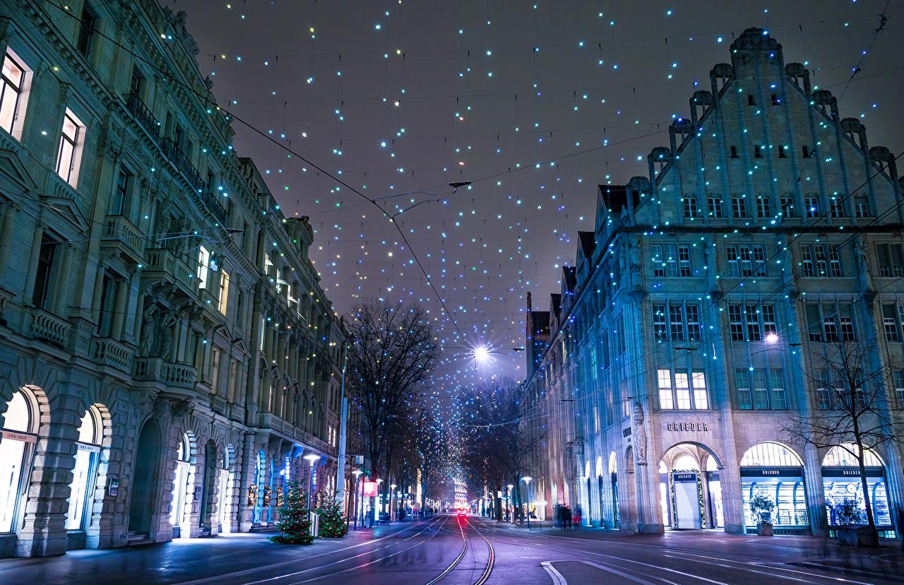 Photo Zurich Christmas Switzerland Winter Street night time Fairy lights Houses Cities New year Night Building