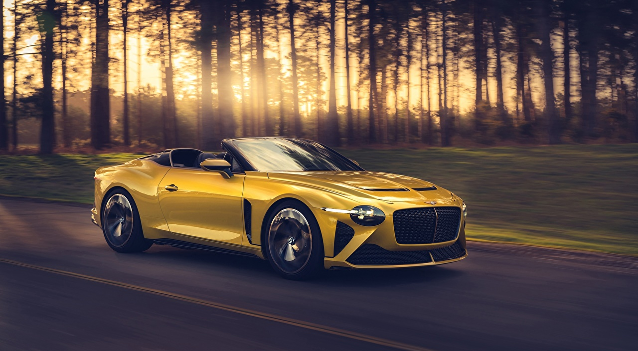 Photos Bentley Mulliner Bacalar Roadster luxurious Yellow at speed Metallic automobile Luxury expensive moving riding Motion driving Cars auto