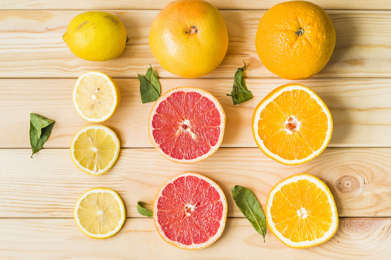 Photo Grapefruit Orange fruit Lemons Food Sliced food Wood planks boards