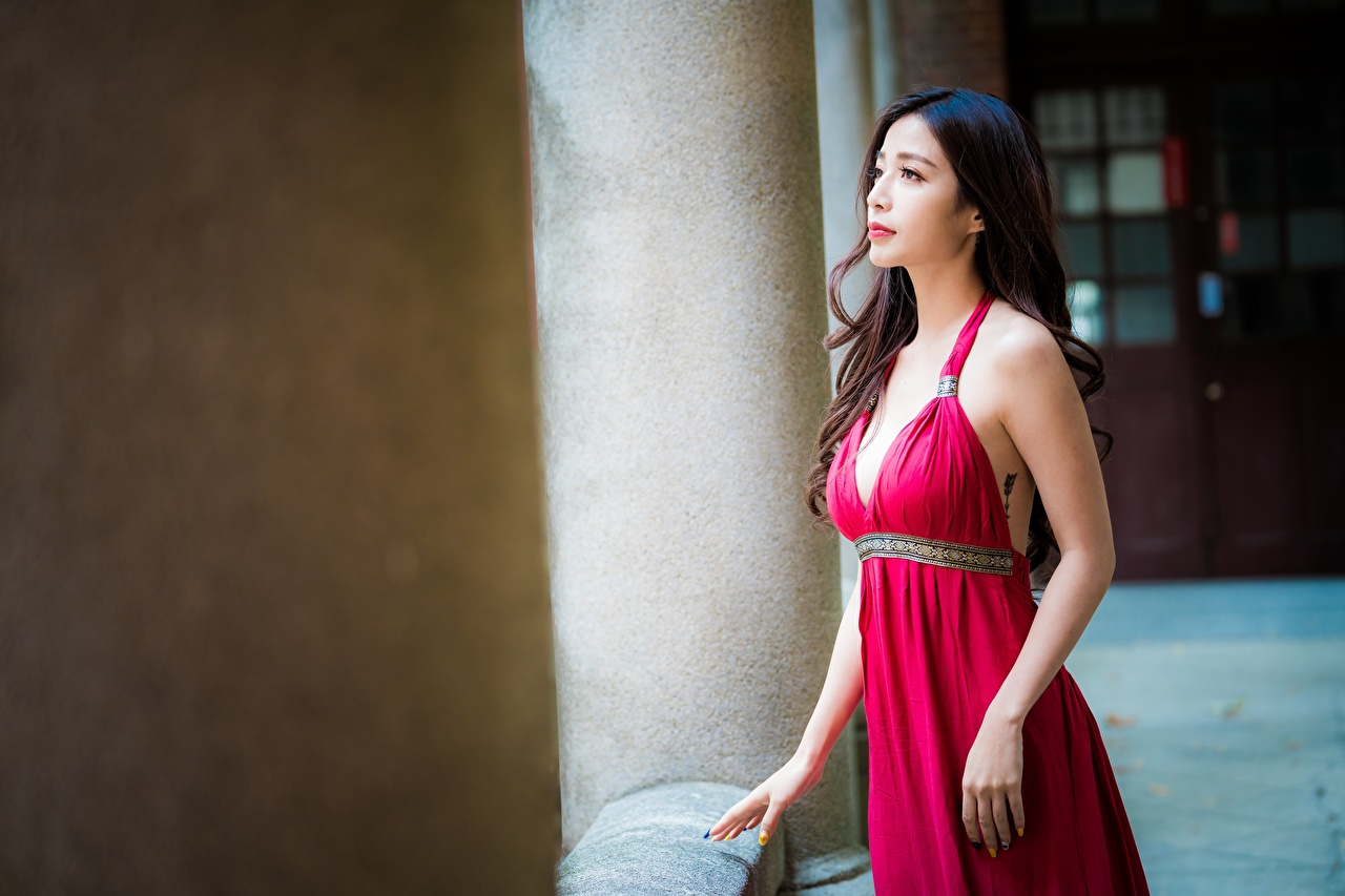 Images Brunette girl blurred background young woman Asian Hands gown Bokeh Girls female Asiatic frock Dress