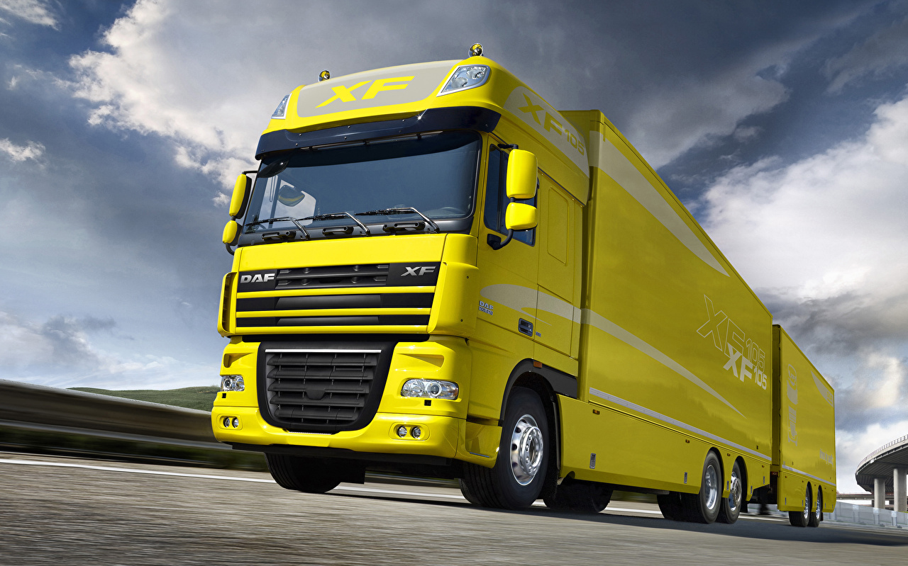 Images lorry DAF Trucks XF105 Yellow Motion Cars Trucks moving riding driving at speed auto automobile