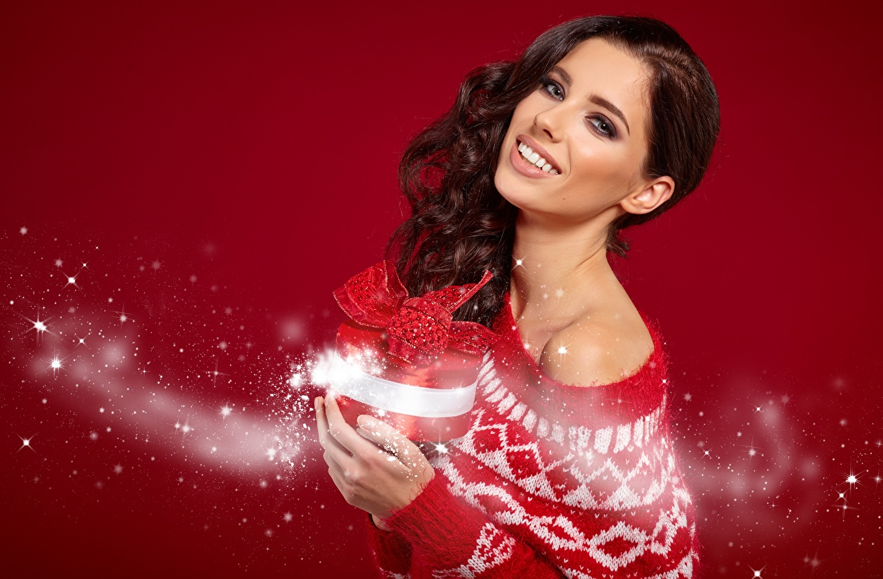 Image Izabela Magier Christmas Smile female Gifts Sweater Glance Red background New year Girls young woman present Staring