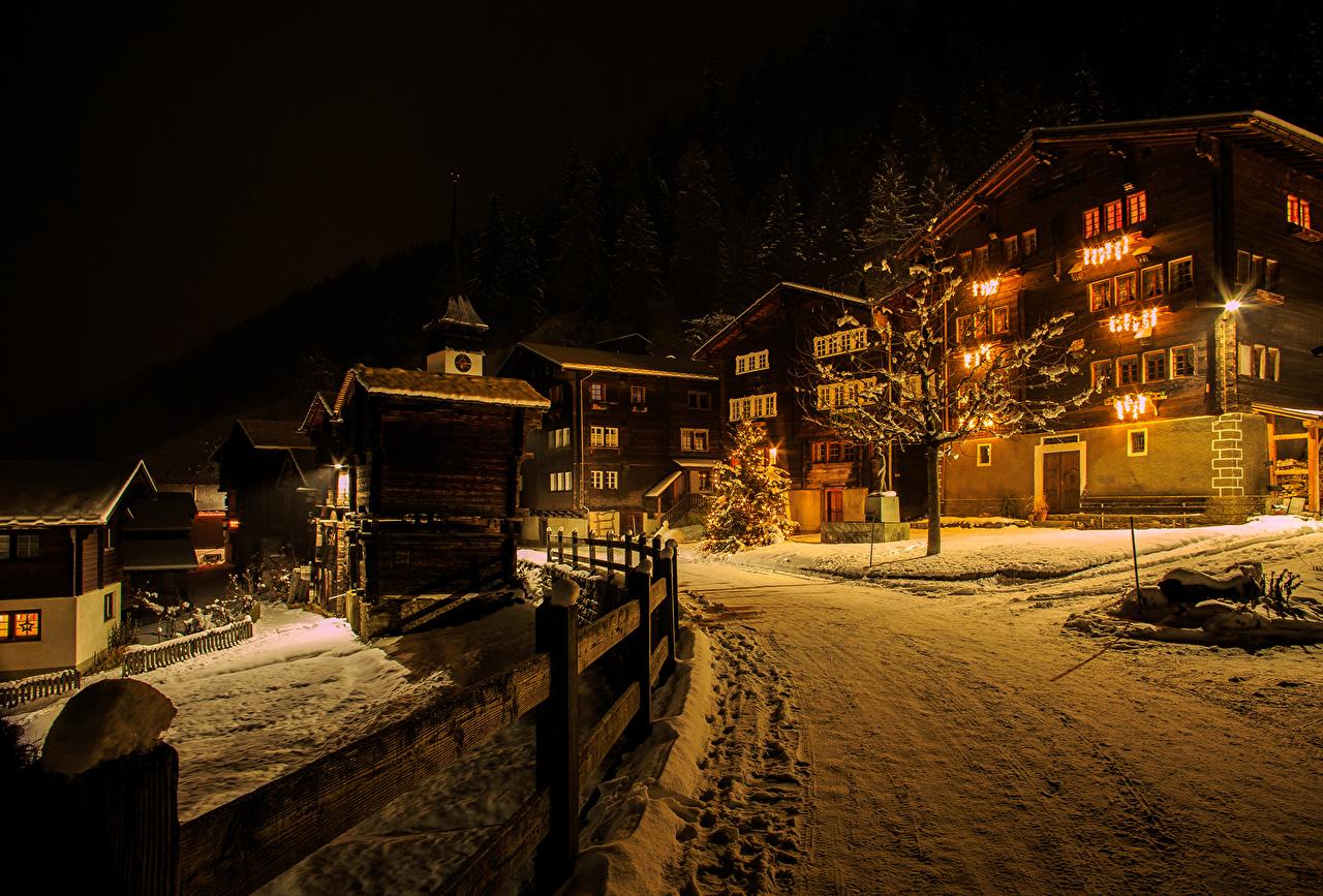 Image Switzerland Niederwald Winter Snow Roads night time Street lights Houses Cities Night Building