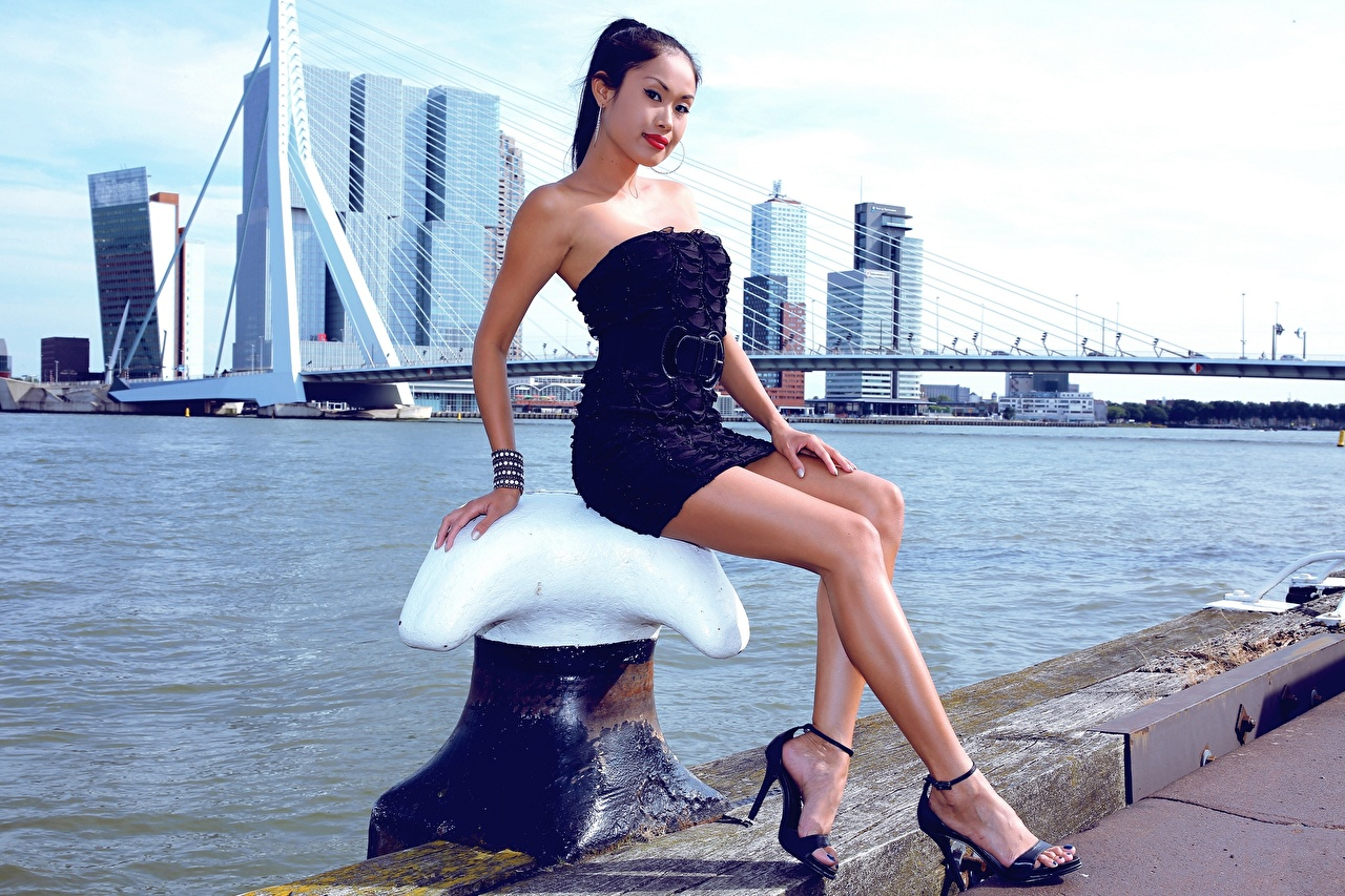 Pictures Brunette girl Bridges young woman Legs Asian Hands Sitting gown high heels Girls bridge female Asiatic sit frock Dress Stilettos