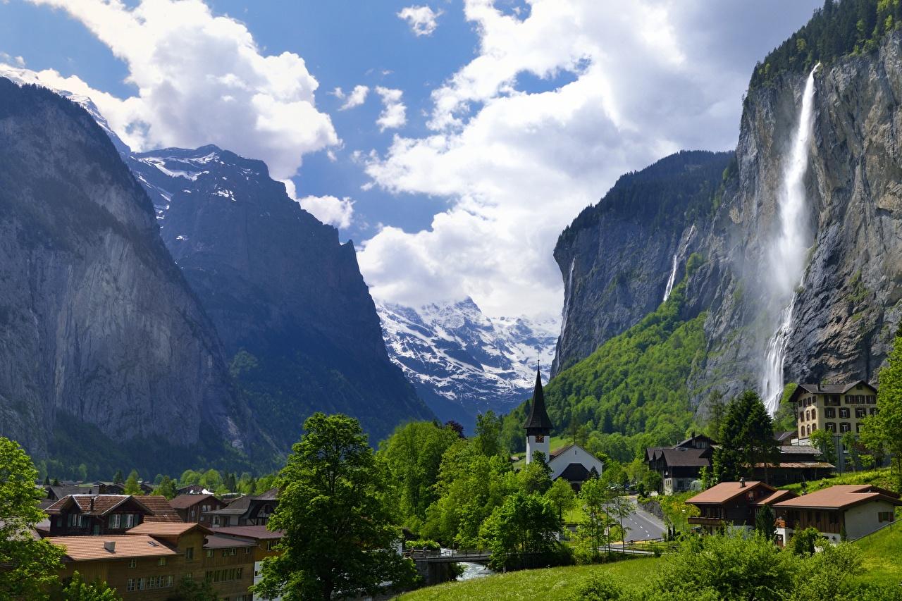 Images Switzerland Village Lauterbrunnen, Staubbach waterfall Rock mountain Waterfalls Cities Crag Cliff Mountains