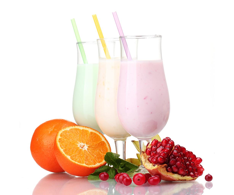 Photo Orange fruit Grain Pomegranate Food Three 3 Stemware Cocktail White background Mixed drink