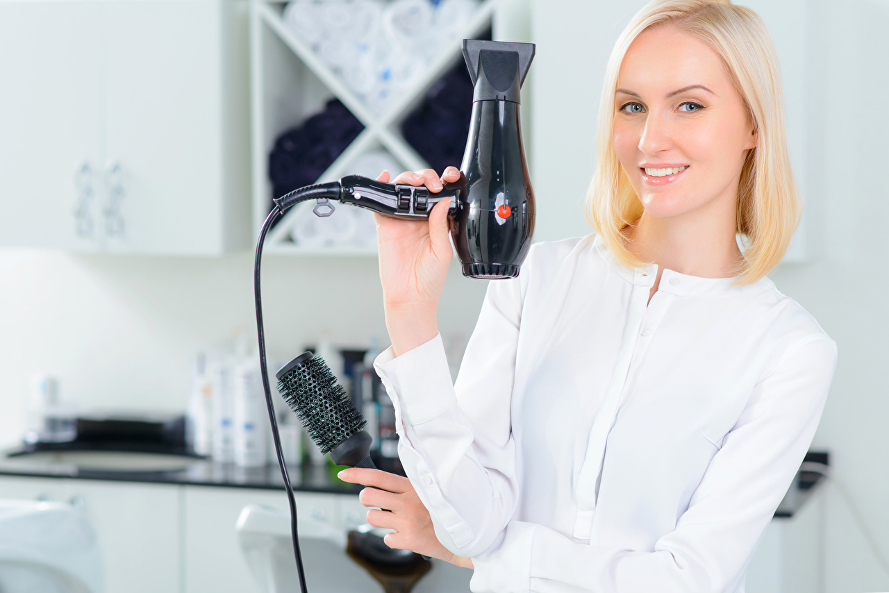 Pictures Girls Blonde girl Smile hairdryer Glance female young woman Hair dryer Staring