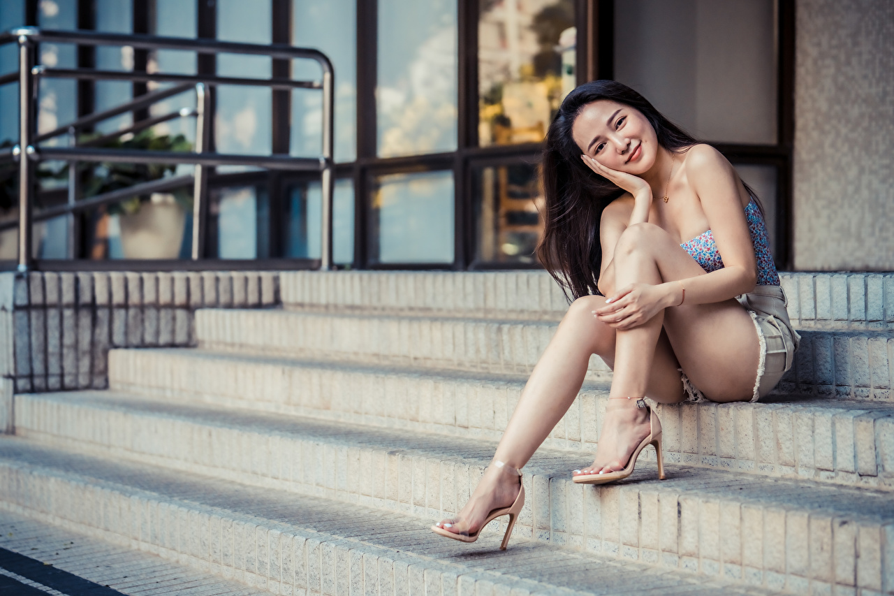 Pictures Smile female staircase Legs Asian Sitting Glance Girls Stairs stairway young woman Asiatic sit Staring