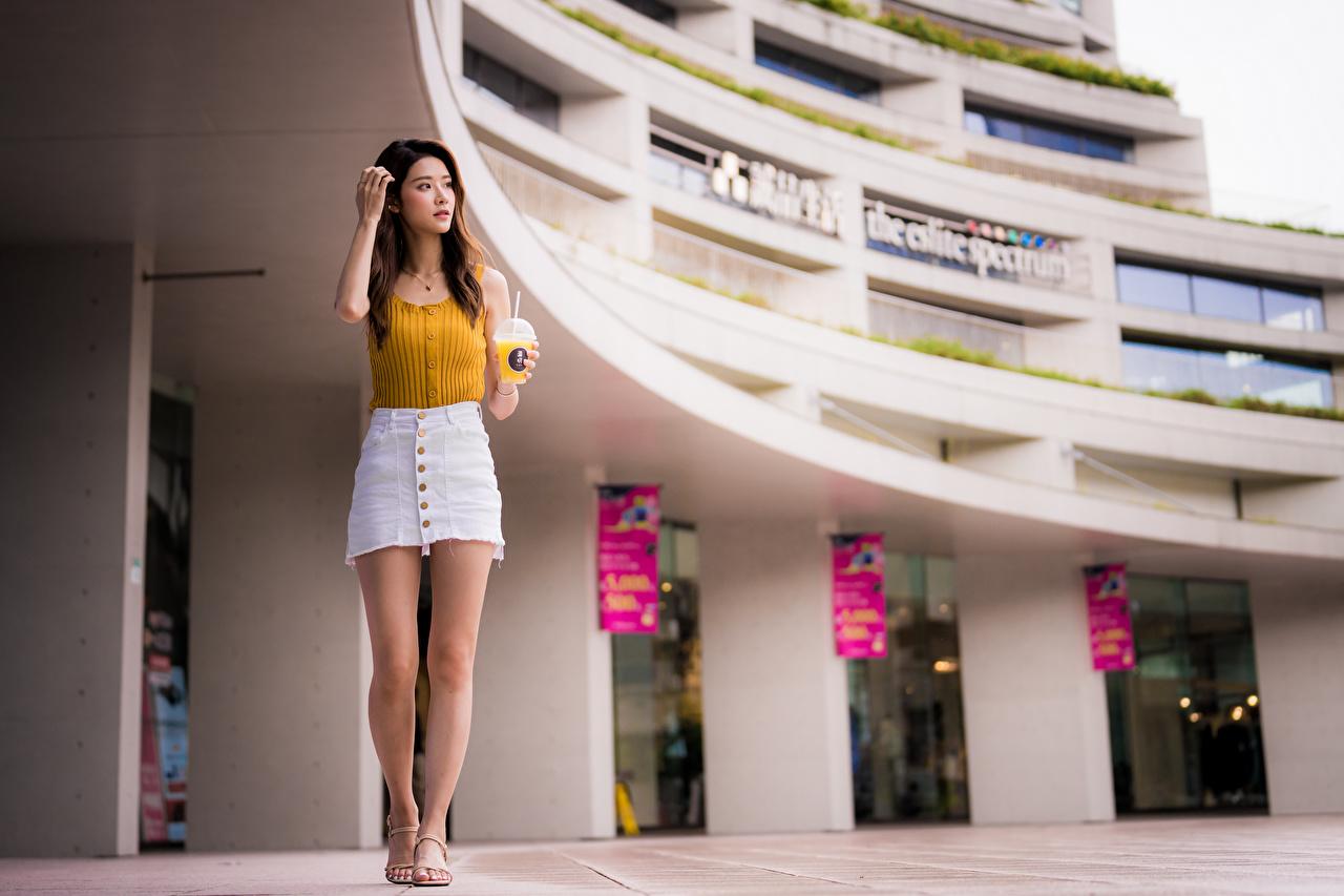 Skrivebordsbakgrunn Skjørt Bokeh Posere Unge kvinner Ben Asiater Ermeløs t-skjorte uklar bakgrunn ung kvinne asiatisk Skjorte Ermeløs