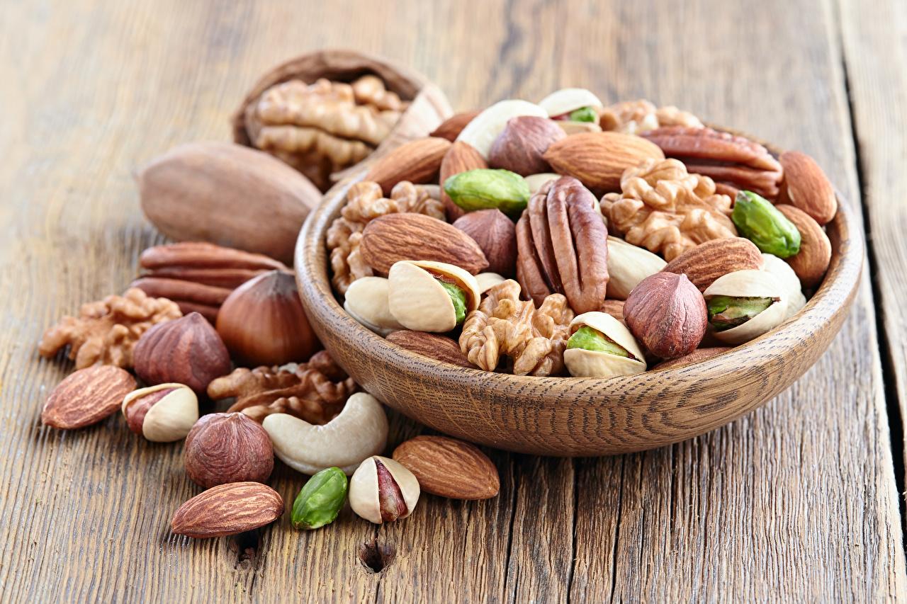 Bilder von Lebensmittel Viel Nussfrüchte Bretter das Essen Schalenobst